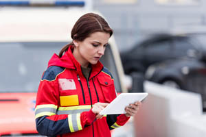 female-emt-holding-tablet
